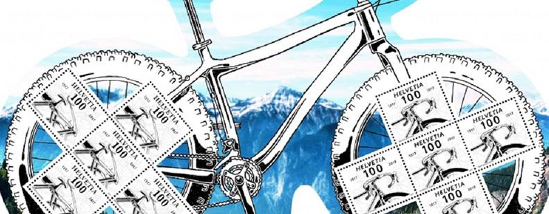 Das Bild zeigte eine der kuriosen Briefmarken – in der Schweiz wurde zum 200-jährigen Jubiläum des Fahrrades 2017 ein Briefmarkenbogen in Fahrradform gedruckt.